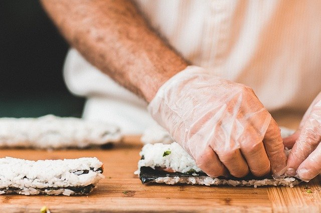 a person making a sushi