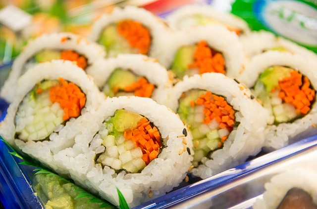 A plastic container filled with sushi
