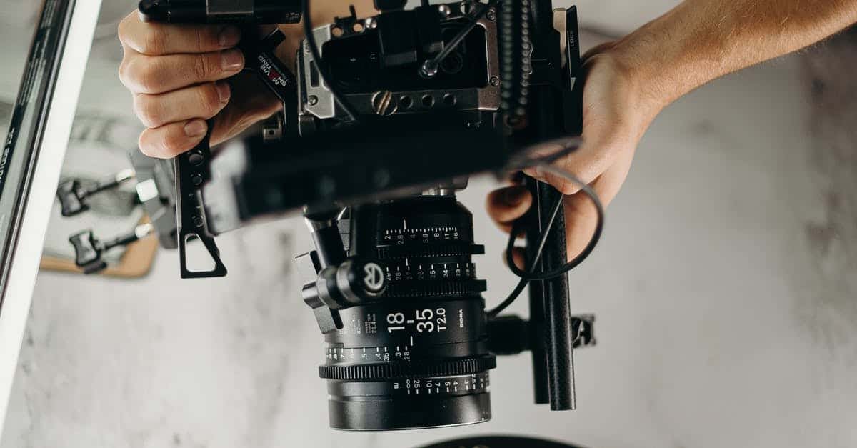 A hand holding a camera