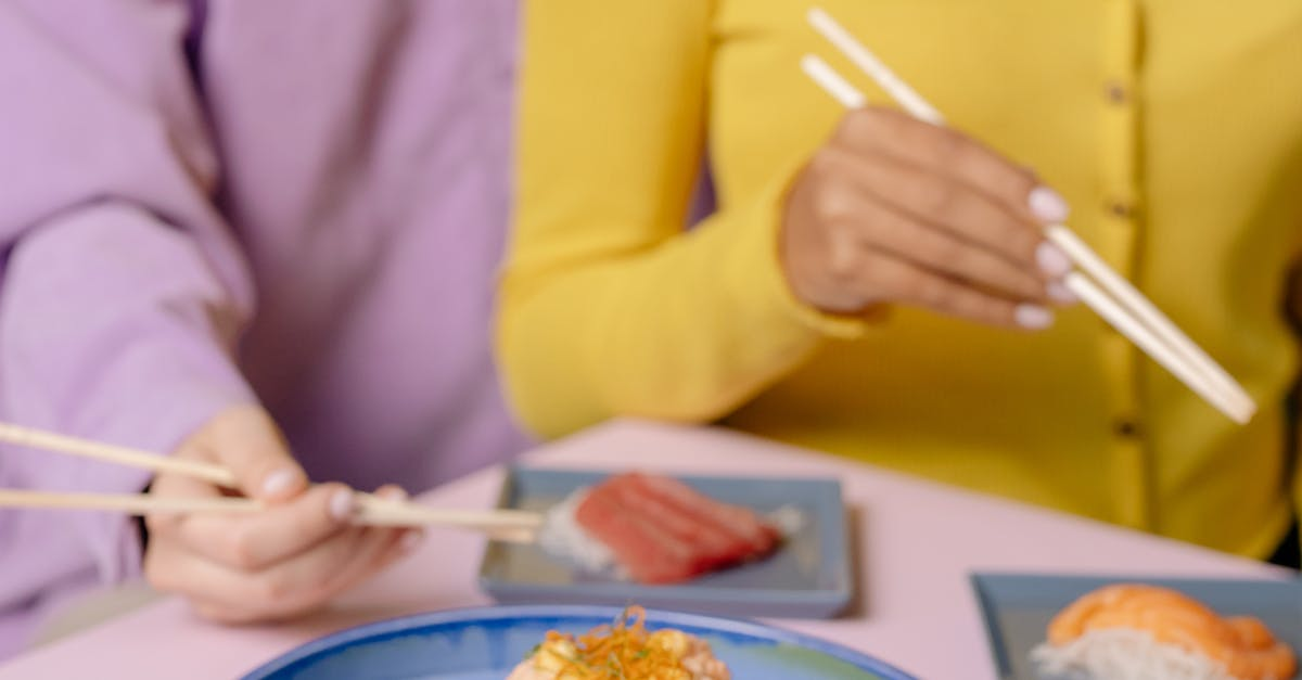 A person sitting at a table with a plate of food